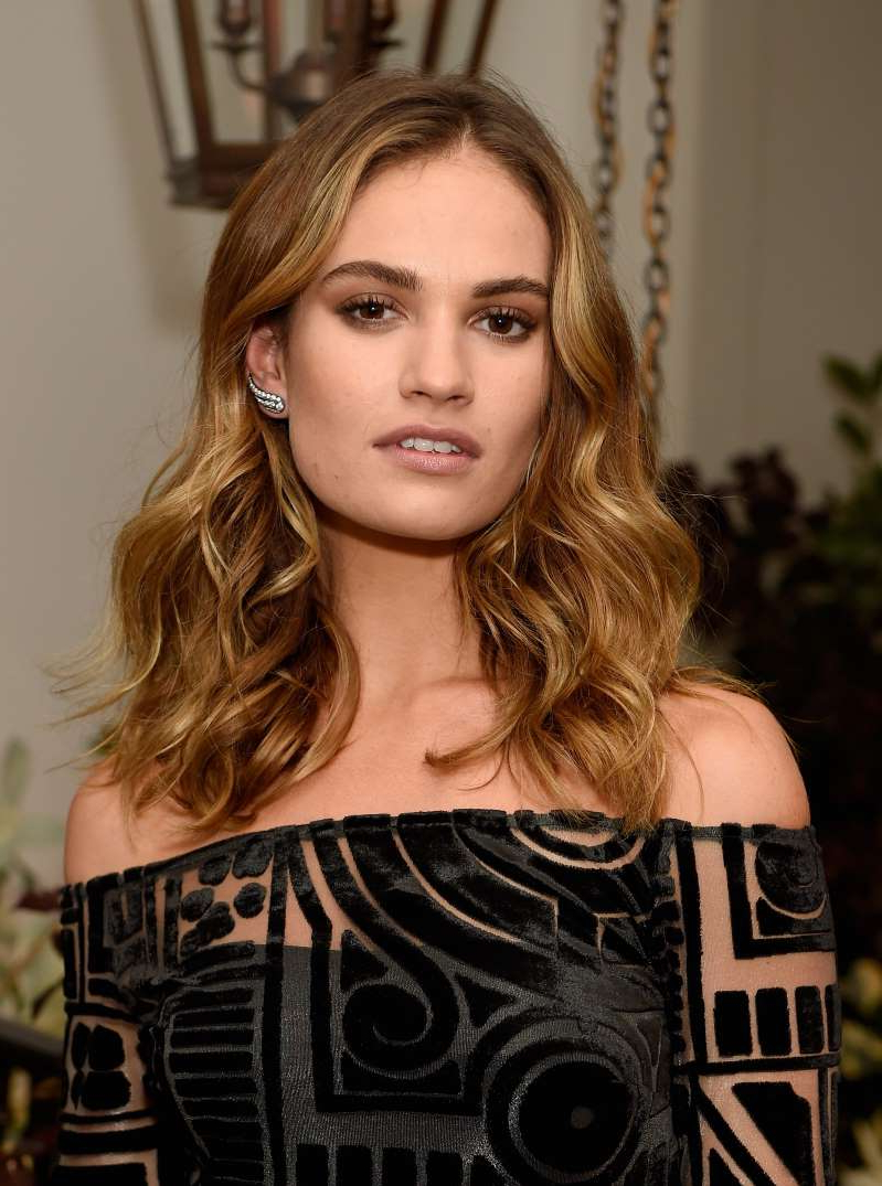 Lily James holding a tattoo: Lily James attends an event to celebrate the launch of My Burberry Black at Burberry's all day cafe Thomas's on August 22, 2016 in London, England.