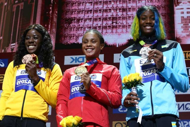 Shaunae Miller et al. around each other: Shaunae Miller-Uibo (left) was less happy with her 2019 world championship silver medal after she learned of gold medallist Bahrain's Salwa Eid Naser problems with doping testers. The bronze medallist was Jamaica's Shericka
