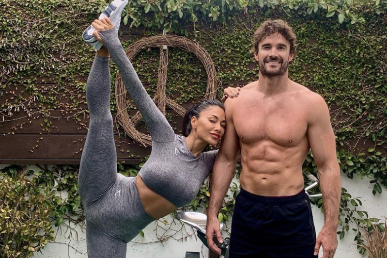 Thom Evans standing in front of a statue: Nicole Scherzinger and Thom Evans have showed off their incredible bodies