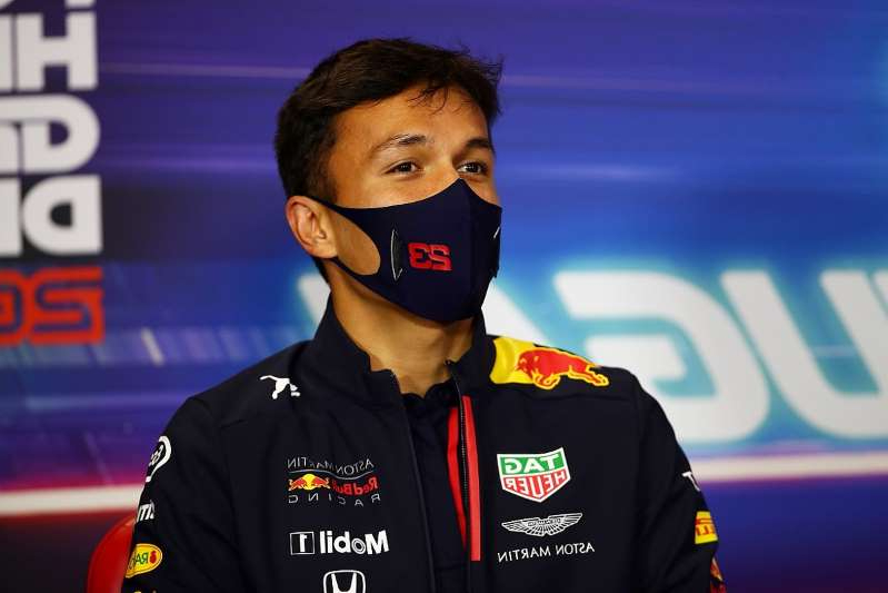 a man wearing a uniform: No extra pressure for Albon amidst replacement rumours