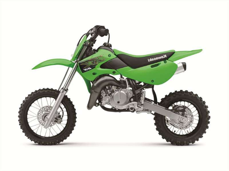 a person riding on the back of a motorcycle: 2020 Kawasaki KX65