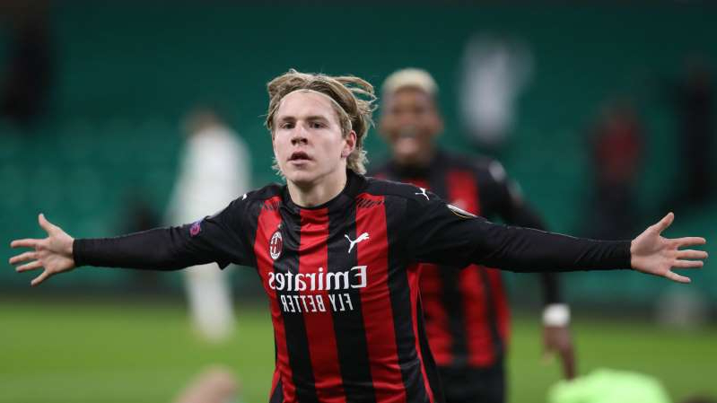 a person throwing a ball: Jens Hauge scored Milan's third goal at Celtic
