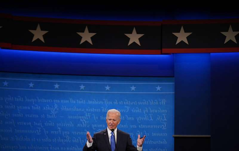 a screen shot of Joe Biden in a suit and tie: Former Vice President Joe Biden speaks during the final presidential debate at Belmont University in Nashville, Tenn., on Oct. 22, 2020.