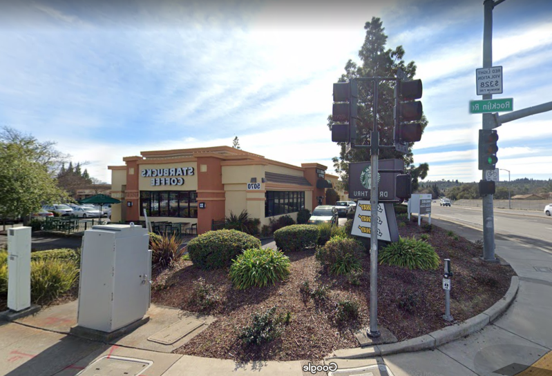 a traffic light sitting on the side of a road: A fight between two men outside a Starbucks at 5070 Rocklin Road left one man dead.