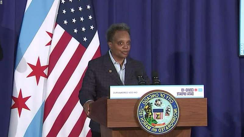 Erica Hunt wearing a suit and tie: Chicago Mayor Lori Lightfoot: