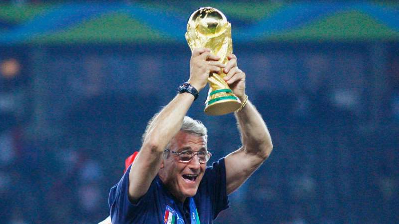 Marcello Lippi holding a racket: Marcello Lippi led Italy to World Cup glory in 2006