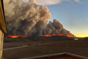 Photos show orange skies, towering smoke over Colorado wildfires as concerns mount over air quality