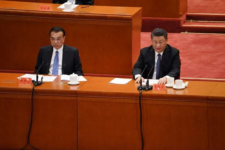 Xi Jinping, Li Keqiang sitting at a desk: Chinese President Xi Jinping issued a sharp warning Friday to potential