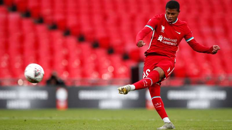 a football player running on a baseball field: Rhian Brewster Liverpool 2020-21