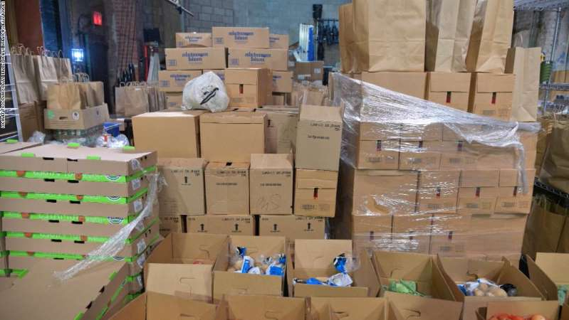 a store inside of a box: The Abrons Arts Center has been designated as one of the Henry Street Settlement hubs for grocery distribution to families in need throughout the Lower East Side on October 06, 2020 in New York City. Food donation and delivery has surged since the start of the pandemic.