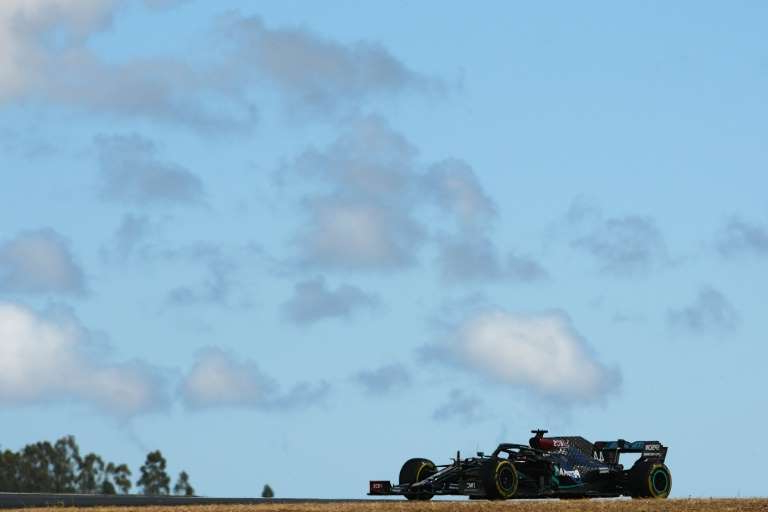 a train on a track with smoke coming out of it: 'You're looking at the sky for a period' said Lewis Hamilton after a challenging first day in Portimao where the The 'undulations are incredible'
