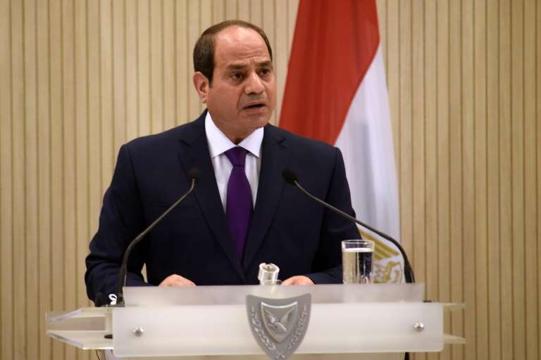 Abdel Fattah el-Sisi in a suit standing in front of a curtain: Egyptian President Abdel Fattah al-Sisi has cracked down on dissent in the past years