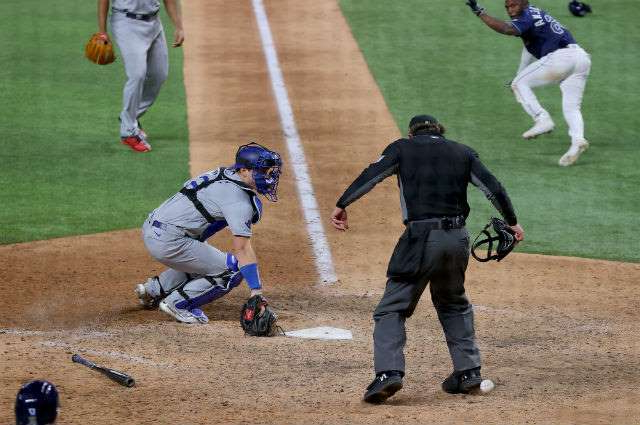 a batter catcher and umpire during a baseball game: Will-Smith-error-102320-Getty-EMBED.jpg
