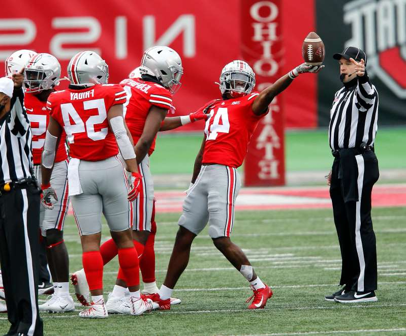 a group of football players on a field: Ohio State safety Josh Proctor (41) recovers the fumble during the fourth quarter against Nebraska at Ohio Stadium.