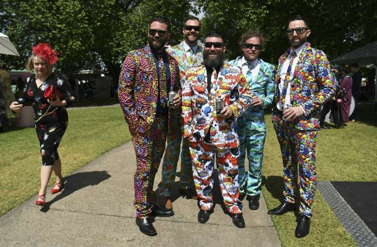a group of people in uniform: Fans will not be allowed at next month's Melbourne Cup due to coronavirus restrictions