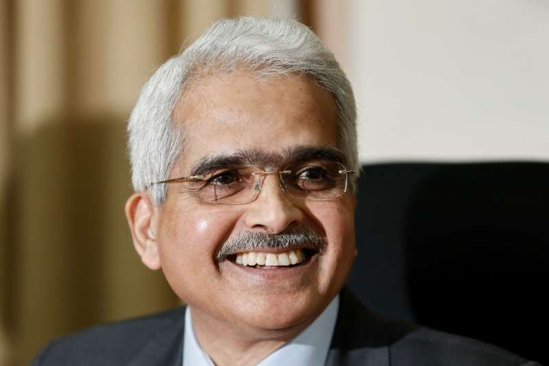 a man wearing a suit and tie smiling and looking at the camera: RBI Governor Shaktikanta Das greets the media in Mumbai