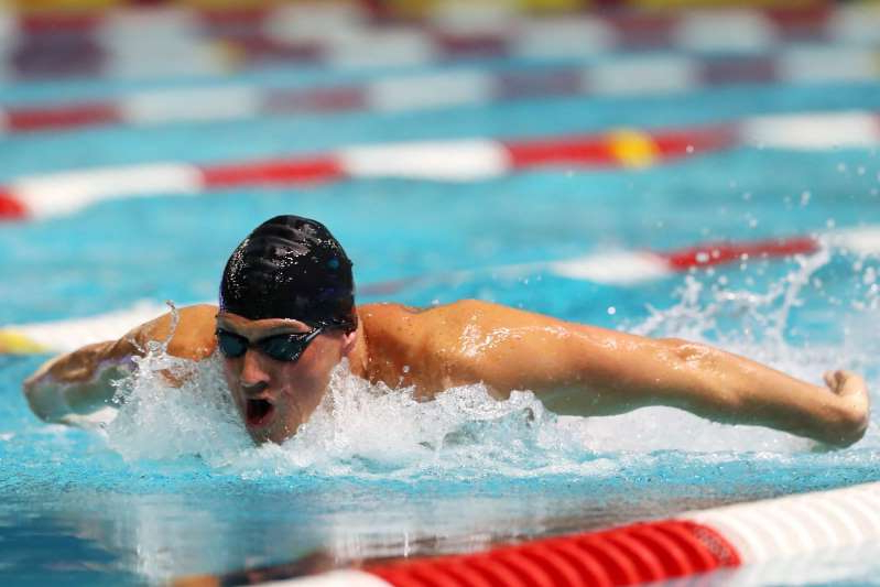 a person swimming in the water: Maddie Meyer/Getty Images Ryan Lochte
