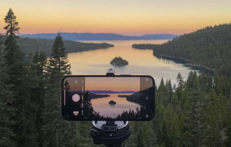 a person taking a selfie in a forest: Shooting with the iPhone 12 Pro above Emerald Bay in Lake Tahoe, California. James Martin/CNET