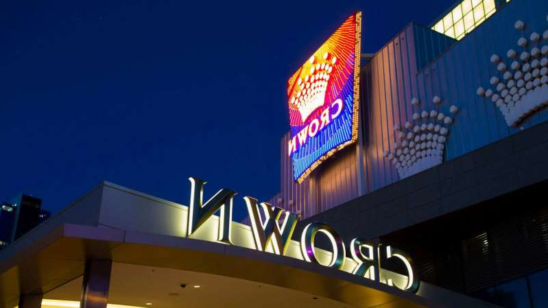 a sign hanging off the side of a building: Crown Resorts has faced months of public hearings. (ABC News: Jane Cowan)