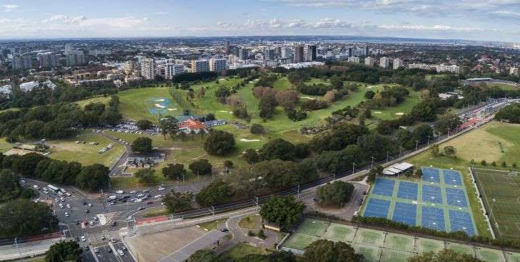 a view of a city: NEWS: View of Moore Park Golf Course with driving range pictured on the right. Photo: Wolter Peeters, 20th May 2020, The Sydney Morning Herald.