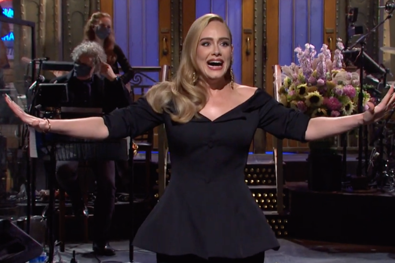 Adele standing in front of a store: Adele thanked Sarah Palin during her Saturday Night Live monologue.