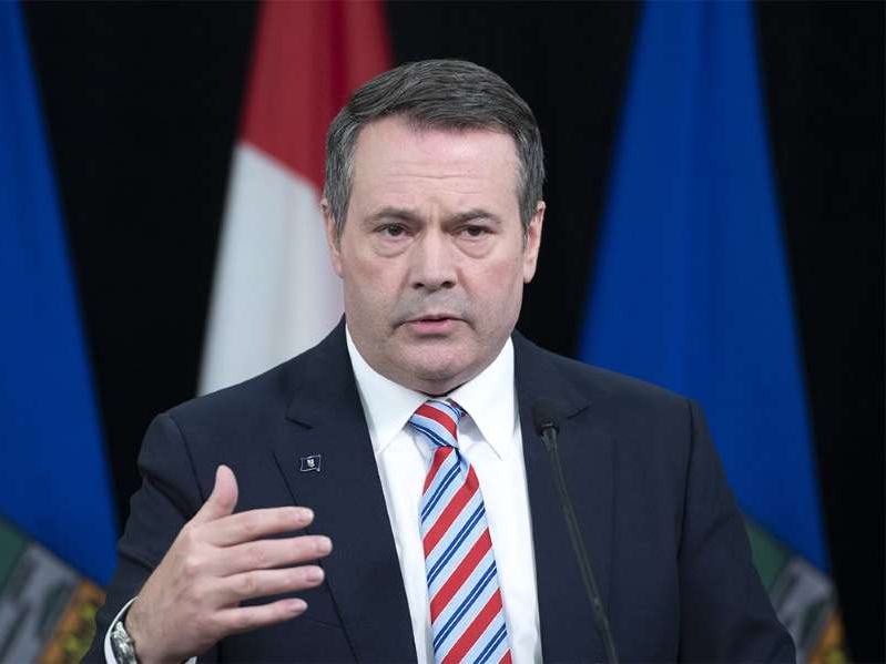 Jason Kenney wearing a suit and tie: Alberta Premier Jason Kenney.