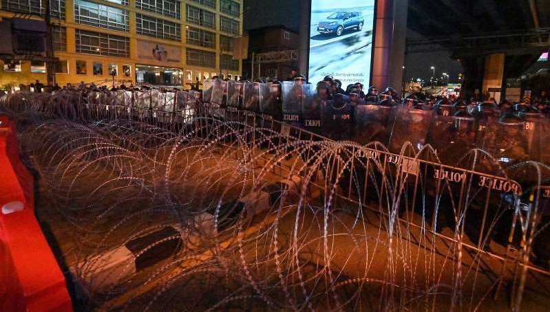 a city at night: Thai Parliament Set to Meet as Protests Continue.