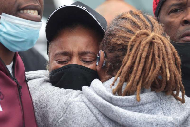 a group of people looking at the camera: WAUKEGAN, ILLINOIS - OCTOBER 22: Sherrellis Stinnette, the grandmother of 19-year-old Marcellis Stinnette, joins demonstrators protesting the October 20 police shooting that left her grandson dead and his girlfriend, 20-year-old Tafara Williams, with serious injuries on October 22, 2020 in Waukegan, Illinois. About 100 protestors, including many family members of the shooting victims, marched from the shooting scene to City Hall, making stops at the police station and courthouse along the way. The demonstrators denounced violence but demanded accountability in statements along the way.