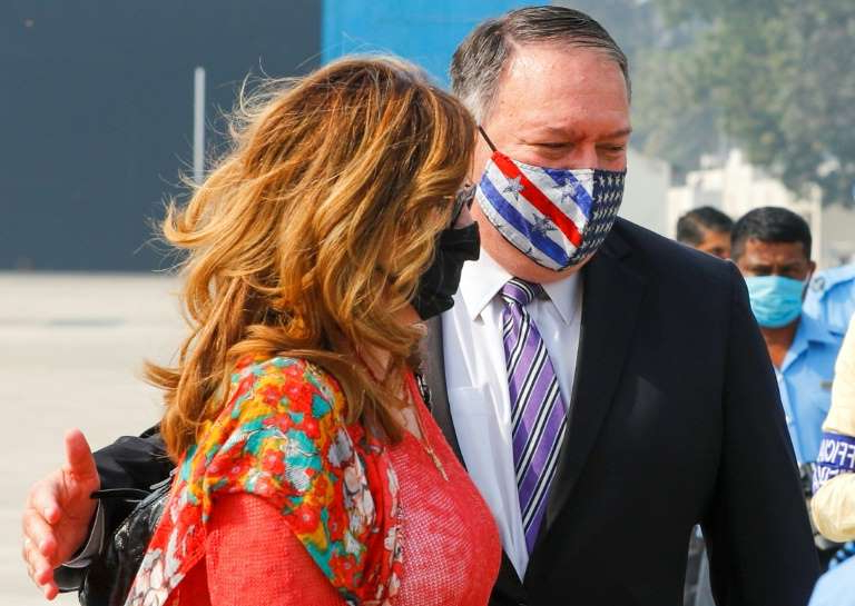 a man and a woman talking on a cell phone: US Secretary of State Mike Pompeo will visit four countries in Asia