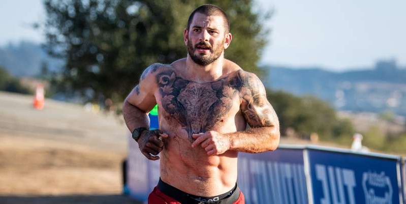 a man in a blue shirt: CrossFit champion Mat Fraser dominated the field of the 2020 Games to become the sport's first five-time champion, besting Rich Froning.