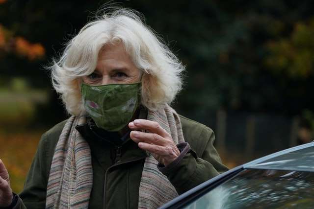 a woman talking on a cell phone: Camilla wore a face mask when she arrived at the event (Arthur Edwards/The Sun)