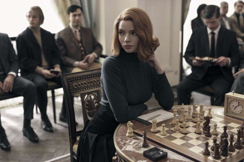Anya Taylor-Joy et al. sitting at a table: 'The Queen's Gambit' sees Anya Taylor-Joy play a chess prodigy addicted to green pills called