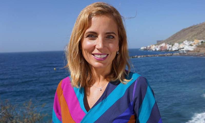 Jasmine Harman smiling next to a body of water: Hello! Magazine