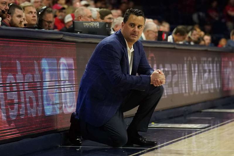 Sean Miller wearing a suit and tie: Arizona basketball coach Sean Miller and the university were hit with several NCAA allegations last week. (AP/Rick Scuteri)