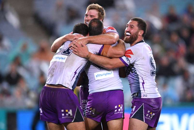 The storm celebrate their win in the NRL Grand Final between the Penrith Panthers and Melbourne Storm at ANZ Stadium in Sydney
