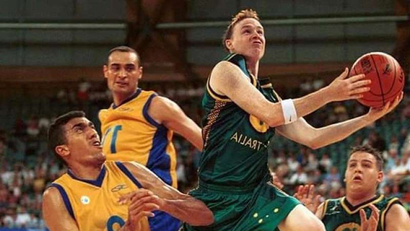 a basketball player with a football ball: The Sydney 2000 Paralympics are a bittersweet memory for Australian basketballers. (Supplied: Australian Paralympic Committee)