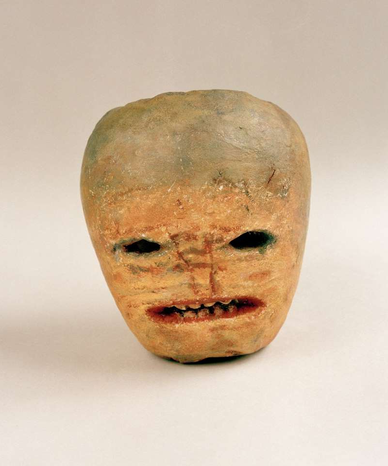 "a close up of a mans face: The National Museum of Ireland—Country Life, near the town of Castlebar, displays a plaster cast of an early 1900s jack-o'-lantern, known as a ""ghost turnip."""