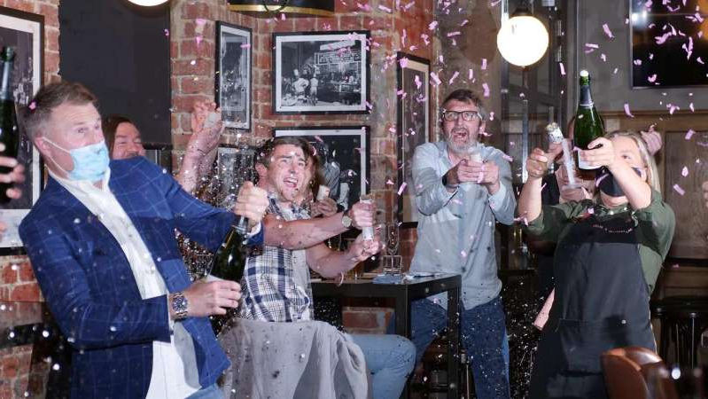 a group of people holding wine glasses: Celebrations inside Melbourne restaurant Angus & Bon went into the early hours of Wednesday. (ABC Melbourne: Kristian Silva)
