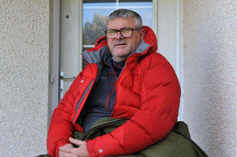 a man sitting in front of a building: Paul McGeoghie was kept up all night by an alarm going off