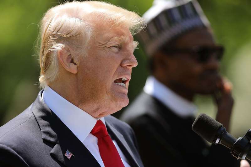 a man wearing a suit and tie: Trump and Nigerian President Buhari held a joint press conference in the Rose Garden in 2018 WASHINGTON, DC - APRIL 30: U.S. President Donald Trump answers reporters' questions during a joint news conference with Nigerian President Muhammadu Buhari in the Rose Garden of the White House April 30, 2018 in Washington, DC. The two leaders also met in the Oval Office to discuss a range of bilateral issues earlier in the day. (Photo by /Getty Images)