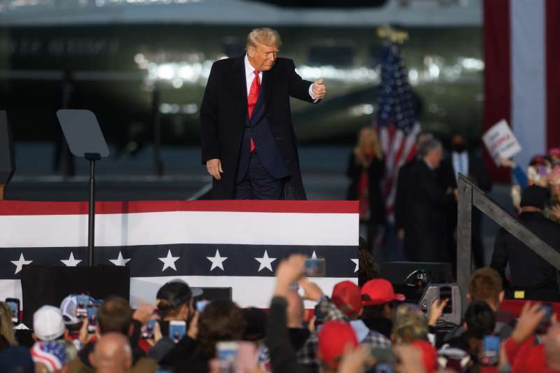 Donald Trump standing in front of a crowd: President Donald Trump held three campaign events in Pennsylvania on Monday as the U.S. presidential election is expected to take place next week.