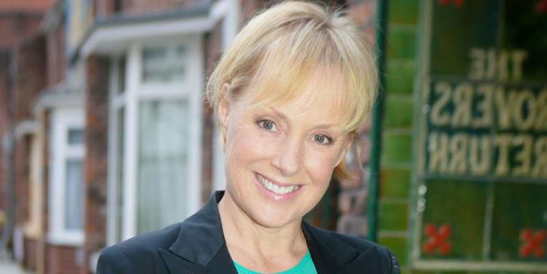 Sally Dynevor smiling for the camera: Debbie remarks to Sally that she couldn't put up with living next door to someone like Geoff.