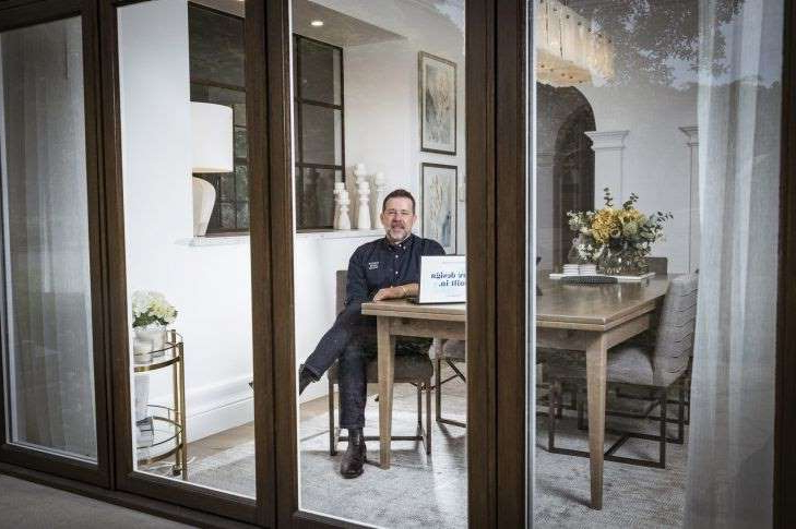 a dining room table in front of a window: 23/10/20 Porter Davis Managing Director Anthony Roberts is redesigning home and urban spaces to deal with the big changes coming post-COVID-19 where a lot more people will be working from home. Photograph by Chris Hopkins