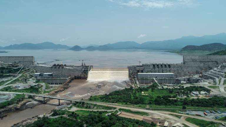 a large building with a mountain in the background: Ethiopia sees the massive dam on the Nile as essential for its electrification and development, but Egypt sees it as an existential threat