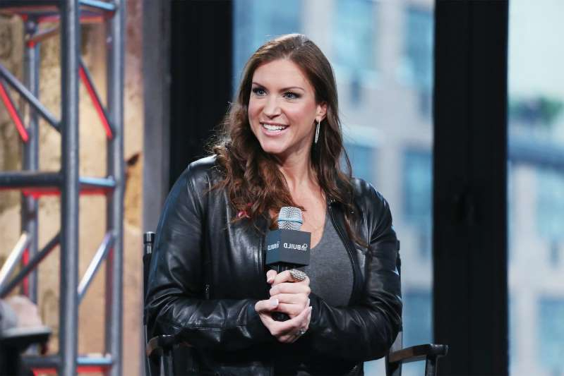 Stephanie McMahon holding a cell phone: Stephanie McMahon is one of the most powerful people at WWE. Photo by Mireya Acierto/FilmMagic