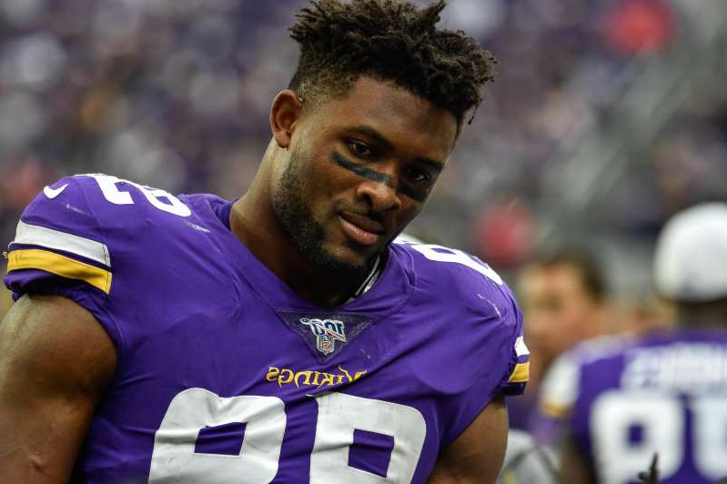 a close up of a man in a blue shirt: Minnesota Vikings defensive end Danielle Hunter won't see the field for even one play in 2020.