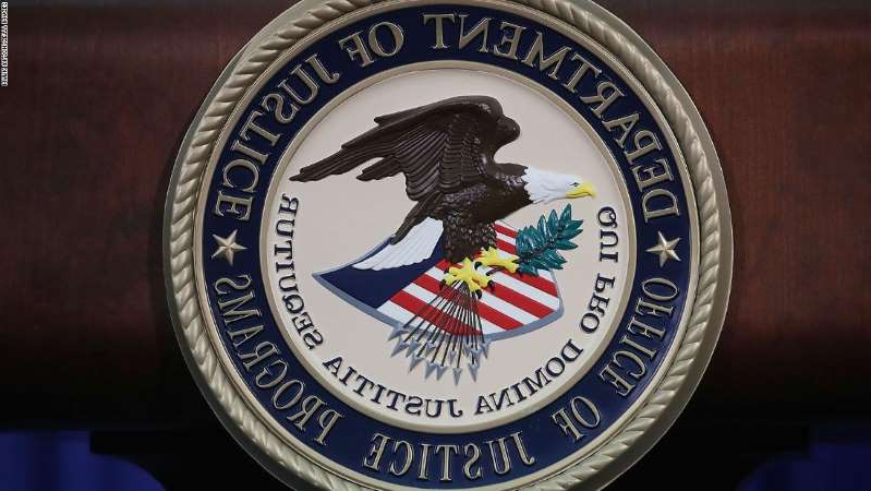 a close up of a sign: The Justice Department seal is seen on the lectern during a Hate Crimes Subcommittee summit on June 29, 2017 in Washington, DC.
