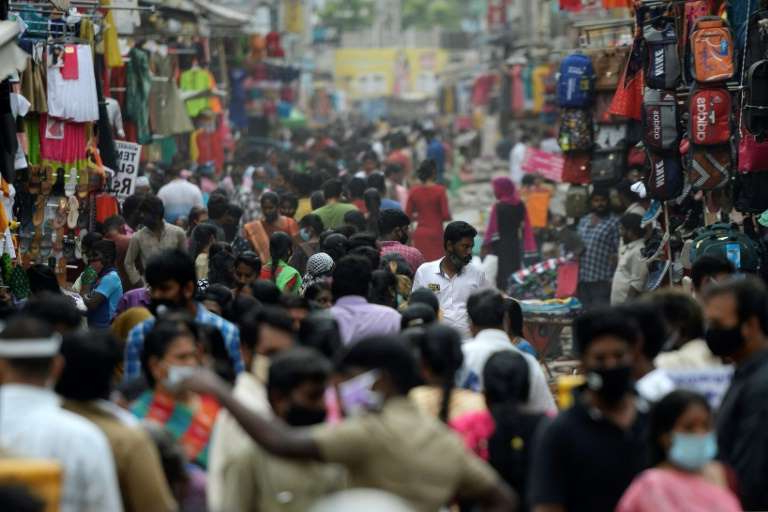 a crowd of people: There have now been 8,040,203 virus cases and 120,527 deaths in India according to government figures