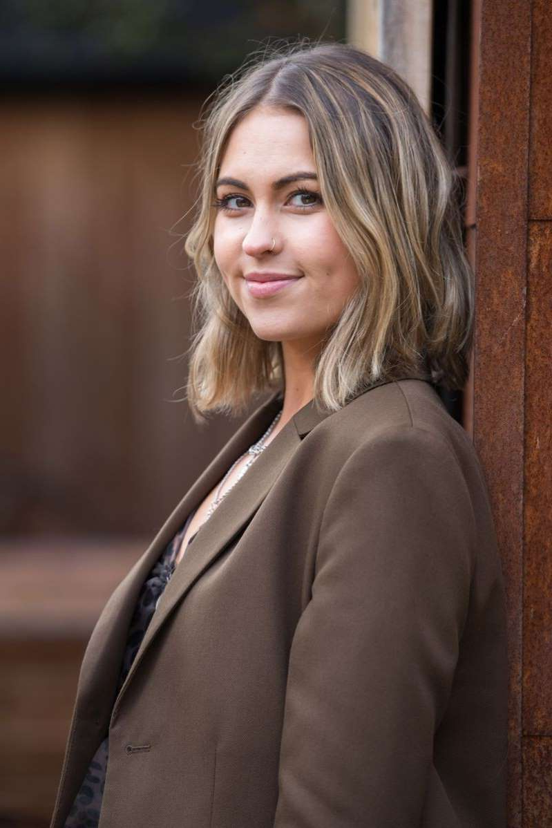 a woman wearing a suit and tie: Rhiannon Clements as Summer Ranger in Hollyoaks