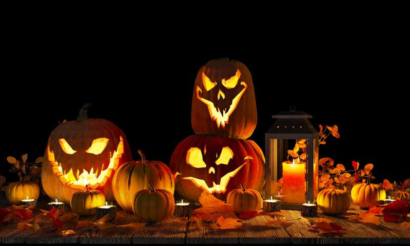 a lamp that is lit up at night: A stock image shows a collection of Jack-o'-lantern representing Halloween. For people with samhainophobia, Halloween causes more than just fun fear.